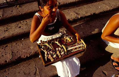 A girl selling religious icons