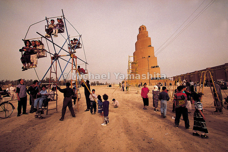 Children's games beneath the magnificent spiral minaret in Samarra, 1100 years old.