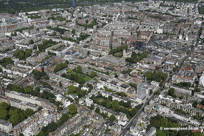 aerial photograph of Chelsea London England UK  showing  King's Rd, Chelsea, London SW3 5EL, Chelsea Common, Manresa Rd  SW3 6LR, Dovehouse Street  SW3 6LA  and in the foreground  Old Church St, London SW3 6EA