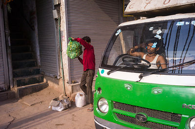 India - Delhi - A man delivering vegetables in the early morning Sitaram Bazar