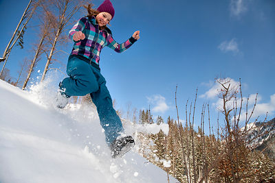 Girl jumping, running in snow