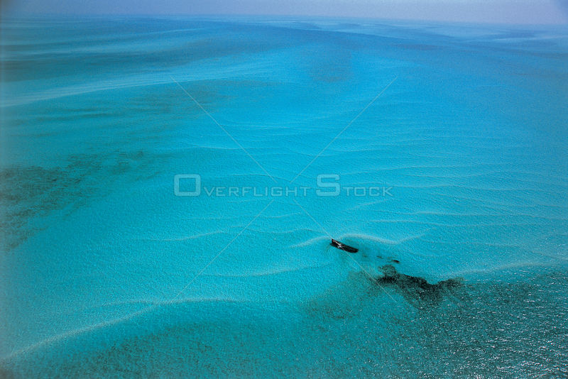Aerial view of shipwreck in shallow coastal waters off The Bahamas, Caribbean Sea