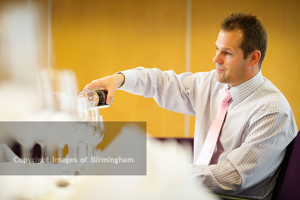 A business man in a hotel, Brindleyplace, Birmingham, West Midlands, England, UK