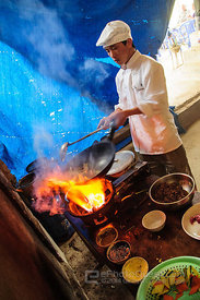 Vietnamese Chef Cooking at Village Restaurant