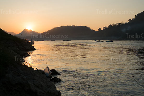 River boats on the Mekong river at dusk in Luang Prabang