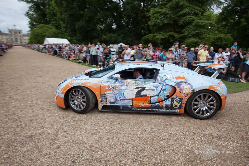 Lord Pembroke and the 'PopBangColour' Bugatti Veyron at the Wilton Classic and Supercar 2013 - Wilton House, Salisbury, Wiltshire, United Kingdom (4th August 2013)