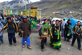 Group of pilgrims and musicians at end of trail to the Sanctuary during Qoyllur Riti festival, Peru