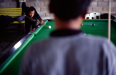 Two Thai men play a game of pool