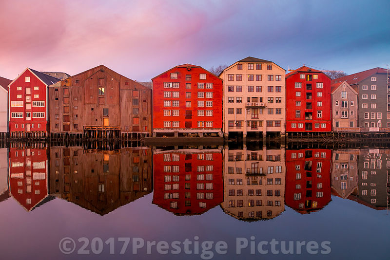Wooden Buildings on Stilts in the Bakklandet district of old Trondheim at Sunrise