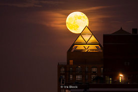 "The ""Supermoon"", the largest full moon of 2013 rises over Manhattan. The pyramid of light is part of Zeckendorf Towers."