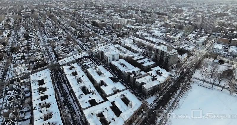 Aerial High Above Brooklyn Snowy Rooftops Streets and Football Fields Winter NYC
