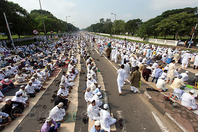 More than 20,000 Muslims pray during Eid al-Adha Red Road, Madian, Kolkata, India. I have the only photos taken by a foreigner of this most important day to Muslims at the most auspicious site in Kolkata for both 2012 and 2013.