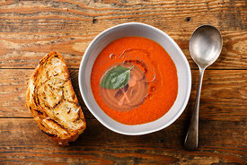 Gazpacho Tomato summer soup and bread on wooden background