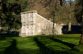 The Temple of Four Seasons facade on the Old Gardeners Cottage, Margam Manor, Neath Port Talbot, South Wales, UK.