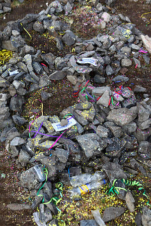 Detail of stones in the shape of plots of land after a challa / blessing ceremony, Qoyllur Riti festival, Peru