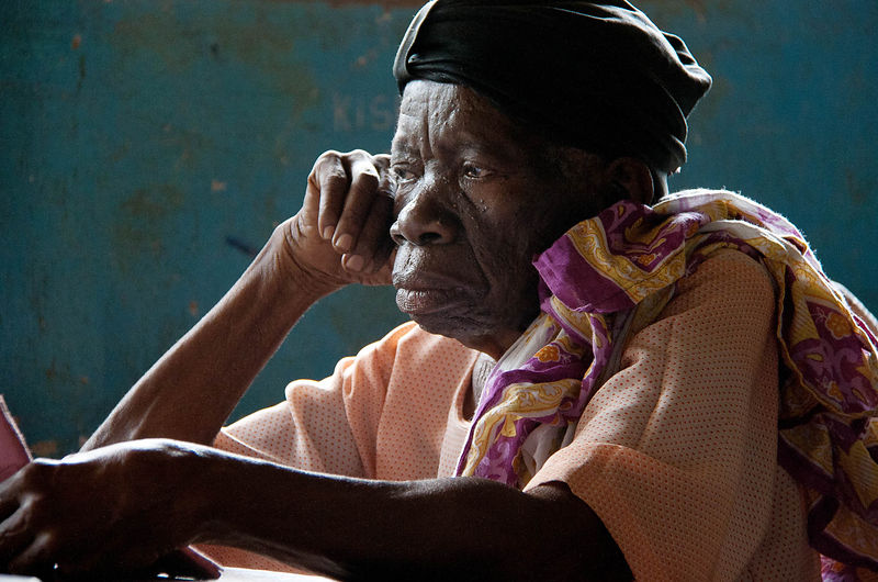 Portrait of a woman waiting for her ears to be syringed, Uzi, Zanzibar, 2010.