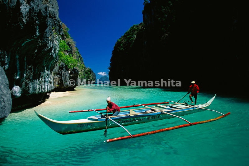The island of El Nido lies between the South China Sea and the Sulu Sea, and like the thousands of other islands in its archipelago is rich in timber, spices, wildlife and fish. Fishermen use the traditional banca with a stabilizing outrigger to ply the clear turquoise waters.  El Nido, Palawan