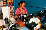 Ghana - Tamale - A young seamstress at work on her sewing machine