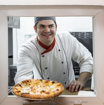 Happy Chef with Fresh Pizza