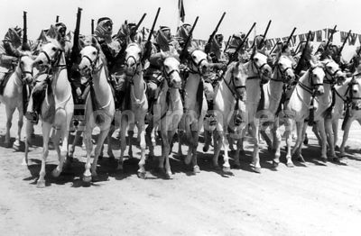 Soldiers of Arab Legion Camel Corps march in honor of King Abdullah I