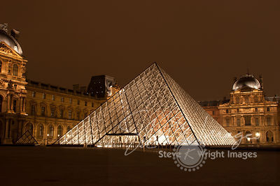 The Louvre Pyramid, Richelieu and Sully Wings of the Louvre Museum at Night - Paris, France