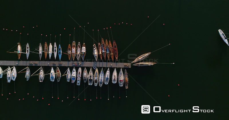 Boats at a harbour, aerial view above a harbor full of yachts and sailboats at liuskasaari island, on a sunny summer evening dusk, Helsinki, Uusimaa, Finland