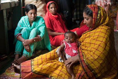 Bangladesh - Dhaka - Passengers with a baby aboard a ferry moored in Sadarghat