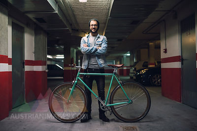 Young man with his fixie bike in a garage