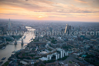 Aerial view over the City at sunset, London