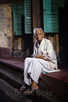 Portrait of an elderly man at night in Bowbazar, Kolkata, India.