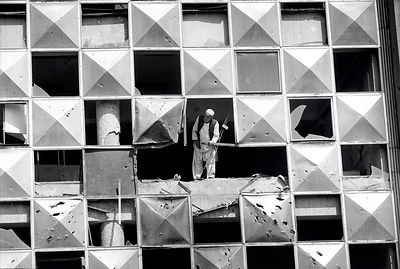 Old man in war damaged building, Kabul. Afghanistan