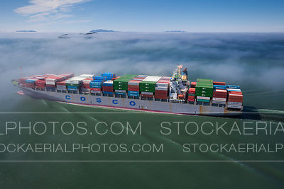 Container Ship Sailing Through Fog
