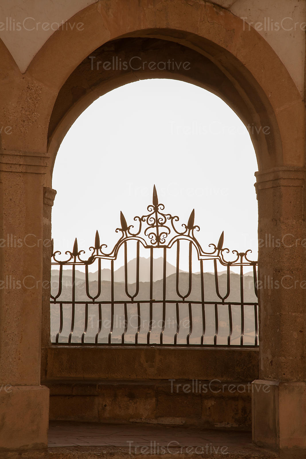 Iron railing of balcony overlooking the mountains, Ronda, Spain
