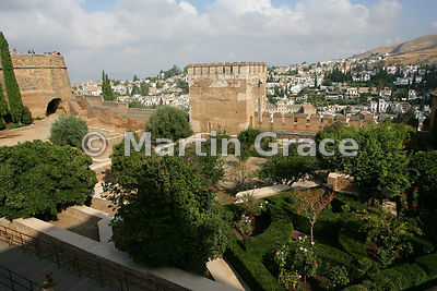 Looking over the Patio de la Madraza, Alhambra, with the Torre del Cubo (The Tub) to the left and the Torre de las Gallinas (centre), to part of Granada beyond