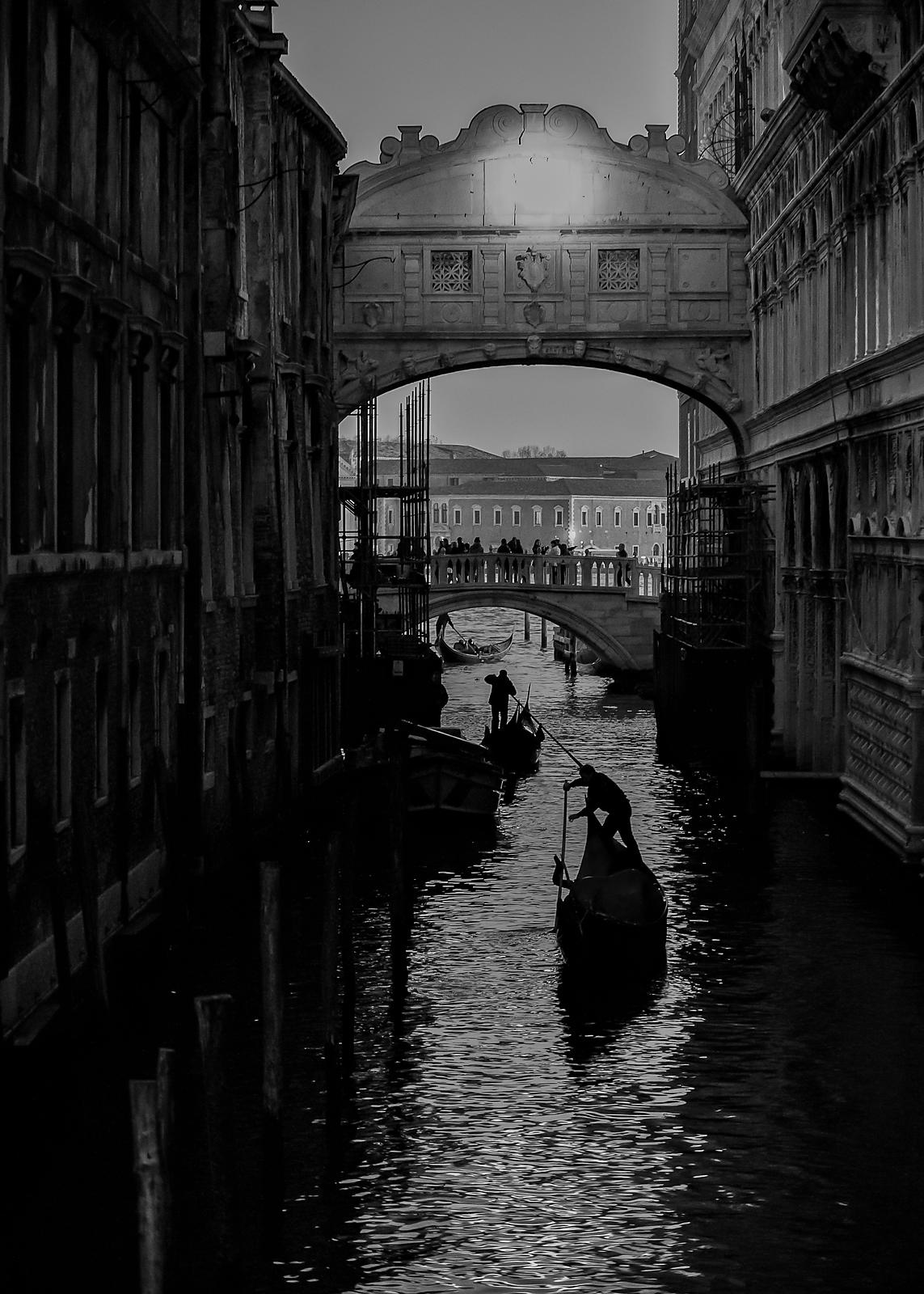 Silhouettes of Gondoliers under the Bridge of Sighs, Venice