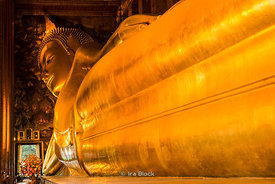 The Reclining Buddha at Wat Pho, a Buddhist temple in Phra Nakhon district, Bangkok, Thailand.