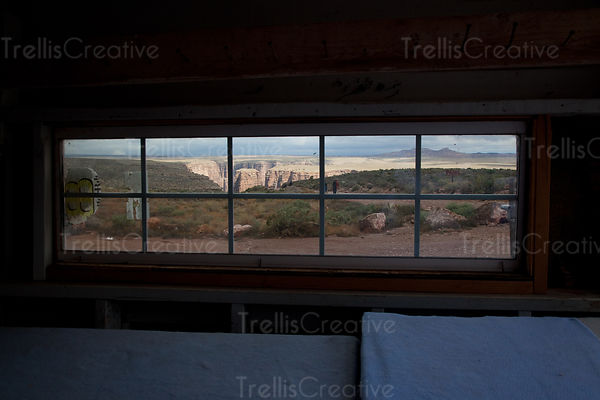Looking through the window of a road-side gift shack at a canyon on the East Rim of the Grand Canyon National Park