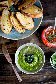 Kale Asiago Pesto Crostini with Quick Pikled Veggies and Basil