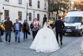 A bride and a groom walking on a street in Istanbul