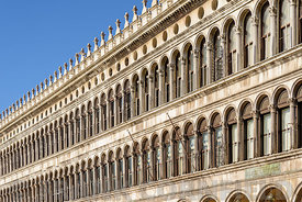 Arch windows of the facade on Piazza San Marco (Saint Mark square) in Venice, Italy.