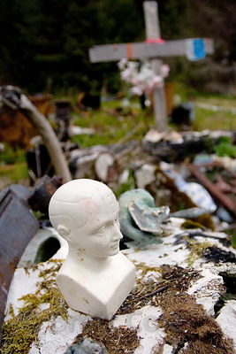 Trash strewn about the yard of an old-timey miner who accidentally burned his house down and perished in the fire, Cape Yakitaga, Lost Coast, Alaska