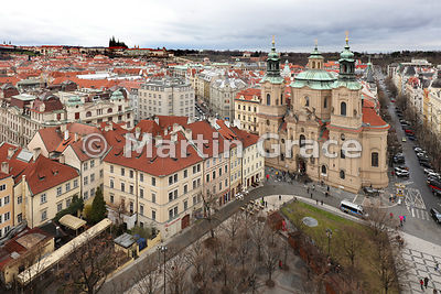 Church of St Nicholas (1732-1737) from Old Town Hall Tower, Old Town Square, with St Vitus's Cathedral on the hill top, Prague, Czech Republic