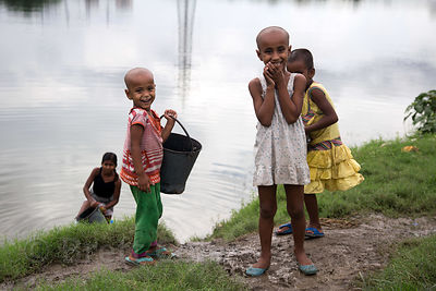 Poor but happy children of laundry workers on Dhopar Pukur Lake, Topsia, Kolkata, India