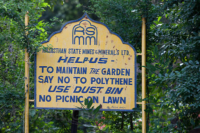Sign imploring Indians not use plastic, Udaipur city rose garden, Rajasthan, India