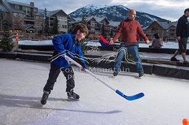 A Family enjoys the ice skating rink at the Whistler Olympic Plaza in Whistler, BC. Photo By Scott Brammer - coastphoto.com