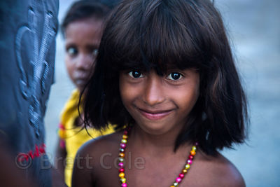 Looking like she just stepped out of Jungle Book, adorable girl at Babughat, Kolkata, India