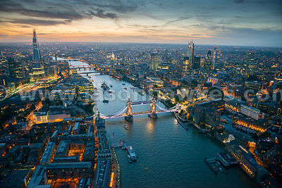 Aerial view of Tower Bridge and the River Thames at night, London