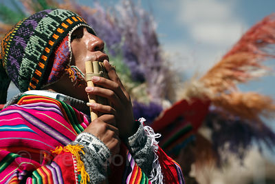 A man plays flute during a parade in Cusco, Peru