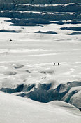 Snowboarders and crevasses