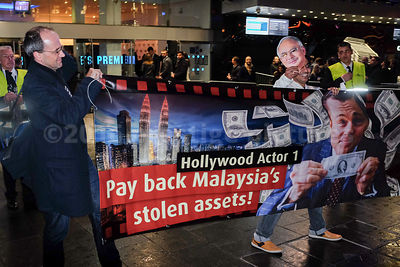 Two Demonstrators Holding up a Banner Accusing Leonardo DiCaprio of accepting Stolen Money